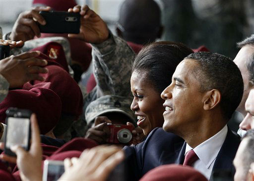 President Barack Obama and first lady Michelle Obama greet troops during their visit to Fort Bragg, N.C., Wednesday, Dec. 14, 2011.  <span class=meta>(AP Photo&#47; Gerry Broome)</span>