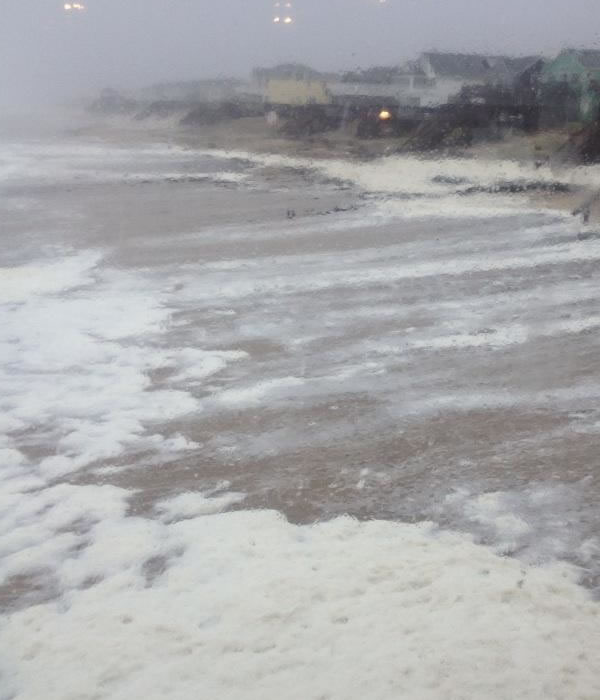 Sea foam making its way up the shore at Nags Head Pier as Hurricane Sandy churns off the North Carolina coast. <span class=meta>(WTVD Photo&#47;Tamara Gibbs)</span>