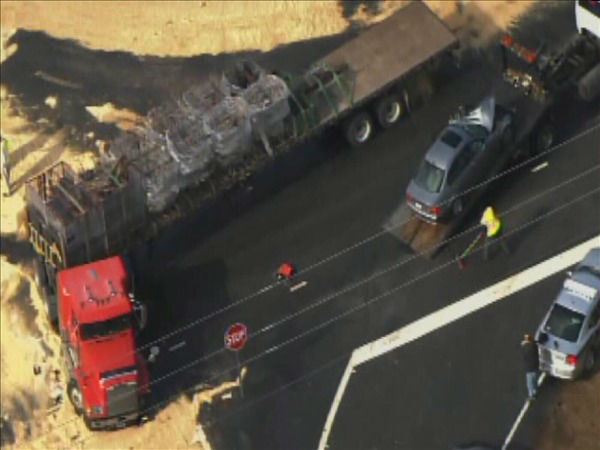 "<div class=""meta image-caption""><div class=""origin-logo origin-image ""><span></span></div><span class=""caption-text"">Firefighters clean up spilled fuel Friday after a tractor-trailer and a BMW collided at the top of the on-ramp at U.S. 1 and New Hill Holleman Rd. in Southwest Wake County. (WTVD Photo/ Chopper 11 HD)</span></div>"