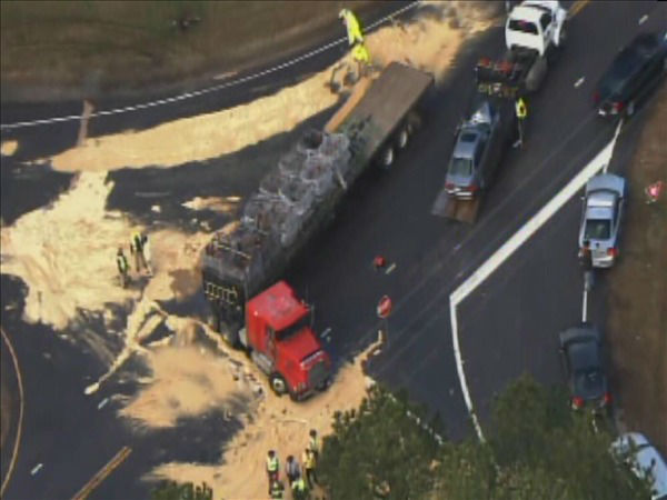 "<div class=""meta ""><span class=""caption-text "">Firefighters clean up spilled fuel Friday after a tractor-trailer and a BMW collided at the top of the on-ramp at U.S. 1 and New Hill Holleman Rd. in Southwest Wake County. (WTVD Photo/ Chopper 11 HD)</span></div>"