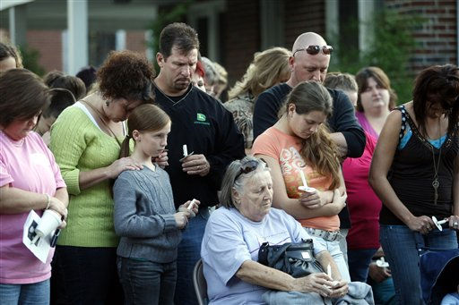People gather for prayer at a candlelight vigil for 10-year-old Zahra Baker in Hickory, N.C., on Wednesday, Oct. 13, 2010.   <span class=meta>(AP Photo&#47; Nell Redmond)</span>