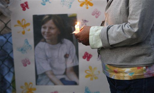 A photo of missing 10-year-old Zahra Baker hangs on a fence during a vigil in Hickory, N.C., on Wednesday, Oct. 13, 2010.  <span class=meta>(AP Photo&#47; Nell Redmond)</span>