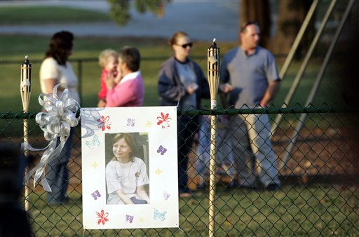 A photo of missing 10-year-old Zahra Baker hangs on a fence as people gather for a vigil for her in Hickory, N.C., on Wednesday, Oct. 13, 2010.   <span class=meta>(AP Photo&#47; Nell Redmond)</span>
