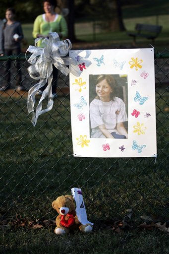A photo of missing 10-year-old Zahra Baker hangs on a fence during a vigil for her in Hickory, N.C., on Wednesday, Oct. 13, 2010.   <span class=meta>(AP Photo&#47; Nell Redmond)</span>