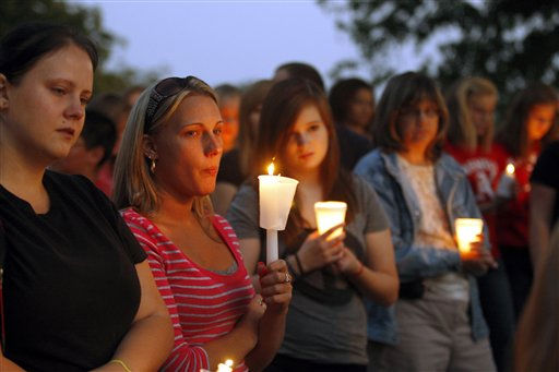 People gather for prayer at a candlelight vigil at East Hickory Baptist Church for 10-year-old Zahra Baker in Hickory, N.C., on Wednesday, Oct. 13, 2010.  <span class=meta>(AP Photo&#47; Nell Redmond)</span>