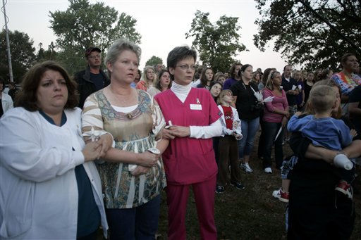 People gather at a candlelight vigil for missing 10-year-old Zahra Baker at East Hickory Baptist Church in Hickory, N.C., on Wednesday, Oct. 13, 2010.  <span class=meta>(AP Photo&#47; Nell Redmond)</span>