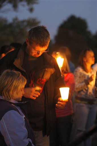 "<div class=""meta image-caption""><div class=""origin-logo origin-image ""><span></span></div><span class=""caption-text"">People gather at a candlelight vigil for missing 10-year-old Zahra Baker at East Hickory Baptist Church in Hickory, N.C., on Wednesday, Oct. 13, 2010.  (AP Photo/ Nell Redmond)</span></div>"