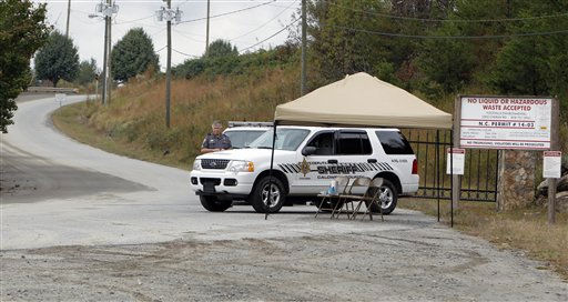"<div class=""meta image-caption""><div class=""origin-logo origin-image ""><span></span></div><span class=""caption-text"">Caldwell County sheriff's officers block the entrance to a landfill in Lenoir, N.C., Wednesday, Oct. 20, 2010 where a search was ongoing related to the disappearance of Zahra Clare Baker.  (AP Photo/ Chuck Burton)</span></div>"
