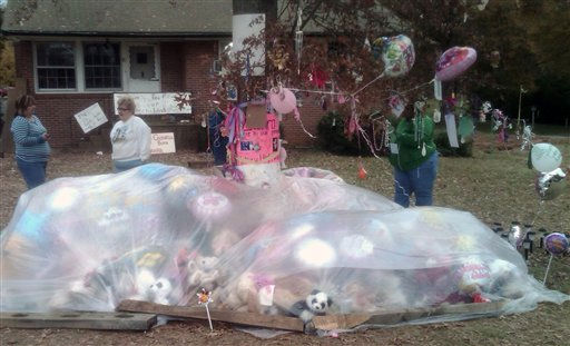 Mourners stop Monday, Nov. 15, 2010, to lay flowers, balloons and stuffed animals outside the home where 10-year-old Zahra Baker had lived with her father and step-mother in Hickory, N.C.  <span class=meta>(AP Photo&#47; Meg Kinnard)</span>