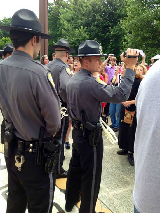 "<div class=""meta image-caption""><div class=""origin-logo origin-image ""><span></span></div><span class=""caption-text"">Protestors and law enforcement at the General Assembly building Wednesday during a Senate vote on abortion restrictions. (WTVD Photo)</span></div>"