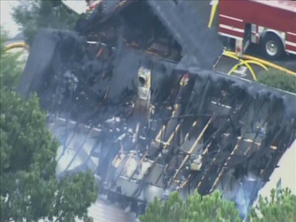 "<div class=""meta ""><span class=""caption-text "">Apex firefighters battled a blaze in a home in the 100 block of Kellerhis Drive Tuesday afternoon. Pictures from Chopper 11 showed heavy damage to the two-story home. (WTVD Photo/ Chopper 11)</span></div>"