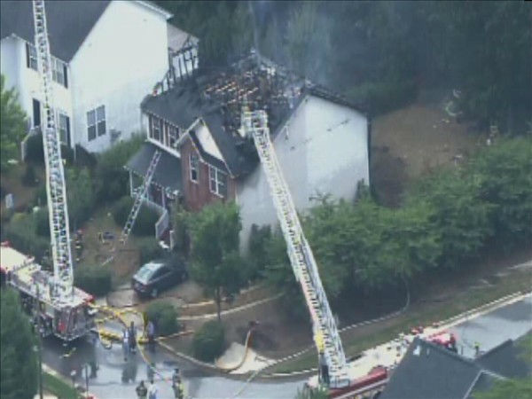 Apex firefighters battled a blaze in a home in the 100 block of Kellerhis Drive Tuesday afternoon. Pictures from Chopper 11 showed heavy damage to the two-story home. <span class=meta>(WTVD Photo&#47; Chopper 11)</span>
