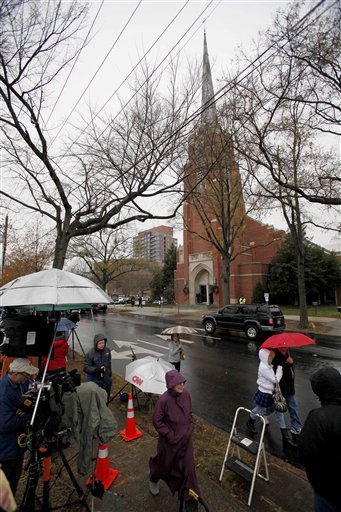 "<div class=""meta image-caption""><div class=""origin-logo origin-image ""><span></span></div><span class=""caption-text"">Onlookers and members of the media gather for the funeral service for Elizabeth Edward at Edenton Street United Methodist Church in Raleigh, N.C., Saturday, Dec. 11, 2010. Edwards, the estranged wife of former North Carolina senator and Democratic presidential candidate John Edwards died Tuesday of cancer at the age of 61.  (AP Photo/ Gerry Broome)</span></div>"