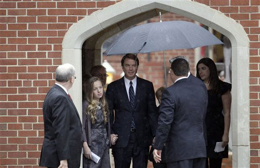 Former Democratic presidential candidate John Edwards and his children, Emma Claire, left, Jack and Cate, far right, leave the funeral service for Elizabeth Edwards at Edenton Street United Methodist Church in Raleigh, N.C., Saturday, Dec. 11, 2010. Edwards died Tuesday of cancer at the age of 61. <span class=meta>(AP Photo&#47; Gerry Broome)</span>