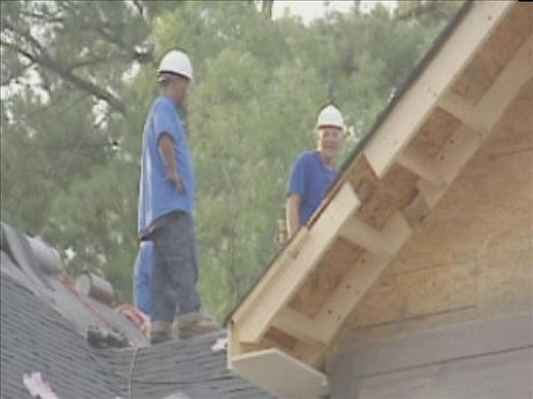 "<div class=""meta ""><span class=""caption-text "">Volunteers work on the Fayetteville home Monday. (WTVD Photo/ Lou Guilette)</span></div>"