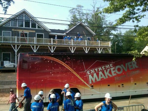 "<div class=""meta ""><span class=""caption-text "">The Extreme Makeover bus parked in front of the home. (WTVD Photo/ Jim Schumacher)</span></div>"