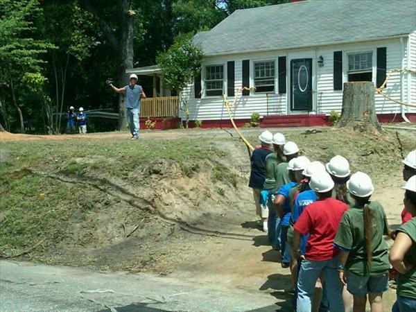 "<div class=""meta ""><span class=""caption-text "">Volunteers get ready to pull down the old home. (WTVD Photo/ Jim Schumacher)</span></div>"