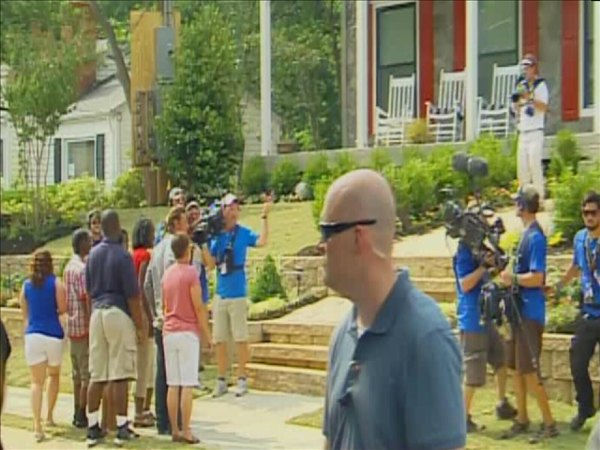 "<div class=""meta ""><span class=""caption-text "">Ty Pennington escorts the Marshalls to their new home (WTVD Photo/ Jim Shumacher)</span></div>"