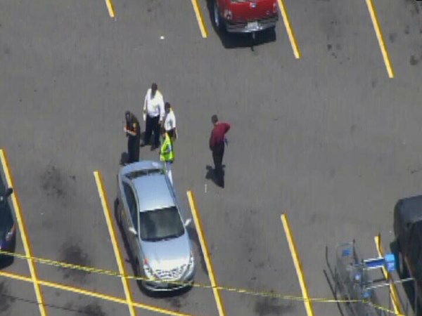 "<div class=""meta image-caption""><div class=""origin-logo origin-image ""><span></span></div><span class=""caption-text"">Police investigate after a gunman allegedly shot  several people near a Walmart in Greenville. (WTVD Photo)</span></div>"