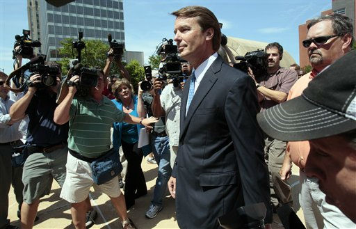 Former presidential candidate John Edwards walks to his vehicle following a court appearance in Winston-Salem, N.C., Friday, June 3, 2011. A grand jury indicted the two-time presidential candidate, accusing him of trying to protect his political ambitions by soliciting and secretly spending more than &#36;925,000 to hide his mistress and their baby from the public.  <span class=meta>(AP Photo&#47; Gerry Broome)</span>