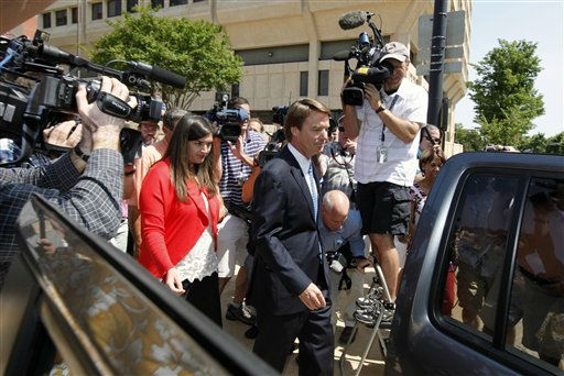 John Edwards, right, leaves the Federal Building with his daughter Cate Edwards, left, in Winston-Salem, N.C., Friday, June 3, 2011. A federal grand jury indicted the two-time presidential candidate, accusing him of trying to protect his political ambitions by soliciting and secretly spending more than &#36;925,000 to hide his Mistress and their baby from the public during the peak of his 2008 presidential campaign. <span class=meta>(AP Photo&#47; Chuck Burton)</span>