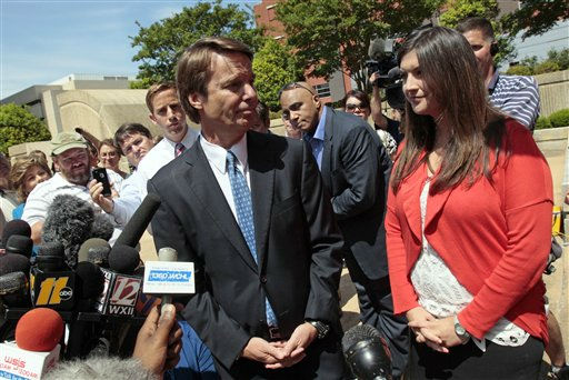 Former presidential candidate John Edwards looks at his daughter Cate, right, after making a statement to the media following a court appearance in Winston-Salem, N.C., Friday, June 3, 2011. A grand jury indicted the two-time presidential candidate, accusing him of trying to protect his political ambitions by soliciting and secretly spending more than &#36;925,000 to hide his mistress and their baby from the public.  <span class=meta>(AP Photo&#47; Gerry Broome)</span>