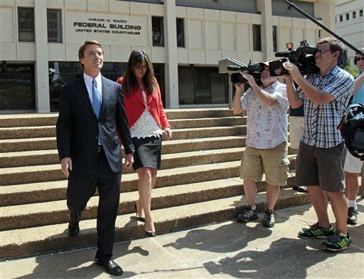 Former presidential candidate John Edwards is seen with his daughter Cate following a court appearance in Winston-Salem, N.C., Friday, June 3, 2011. A grand jury indicted the two-time presidential candidate, accusing him of trying to protect his political ambitions by soliciting and secretly spending more than &#36;925,000 to hide his mistress and their baby from the public.  <span class=meta>(AP Photo&#47; Gerry Broome)</span>