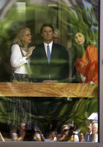"<div class=""meta ""><span class=""caption-text "">Former presidential candidate John Edwards, center, is seen with his daughter Cate, right, as they peer out of the federal building following a court appearance in Winston-Salem, N.C., Friday, June 3, 2011. A grand jury indicted the two-time presidential candidate, accusing him of trying to protect his political ambitions by soliciting and secretly spending more than $925,000 to hide his mistress and their baby from the public.  The person at left is unidentified.  (AP Photo/ Gerry Broome)</span></div>"