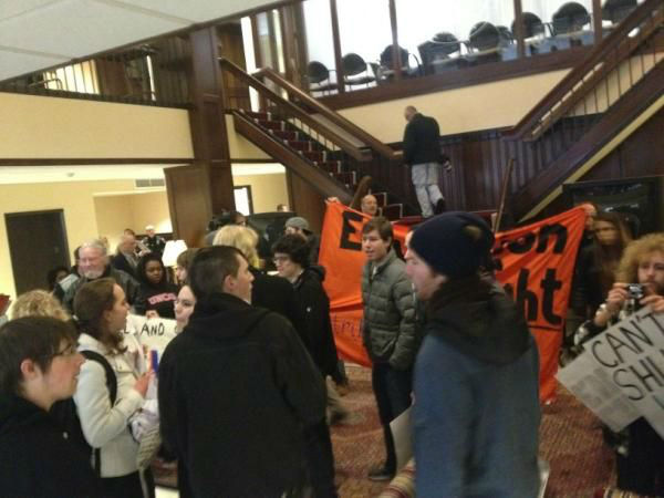 "<div class=""meta ""><span class=""caption-text "">Students from schools in the University of North Carolina system protest in a lobby outside a Board of Governors meeting. (WTVD Photo/ Alina Muchado)</span></div>"