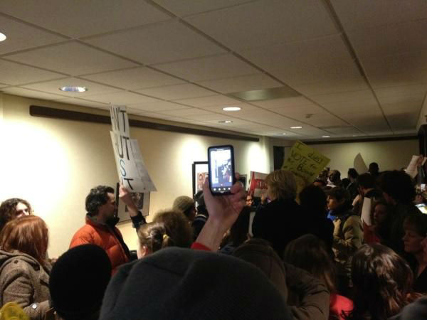 Students from schools in the University of North Carolina system protest in a lobby outside a Board of Governors meeting. <span class=meta>(WTVD Photo&#47; Alina Muchado)</span>