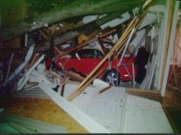 "<div class=""meta image-caption""><div class=""origin-logo origin-image ""><span></span></div><span class=""caption-text"">Storms knocked down trees, ripped off roofs and even crushed a woman's prize Ford Mustang. (WTVD Photo/ Nick Zelano)</span></div>"