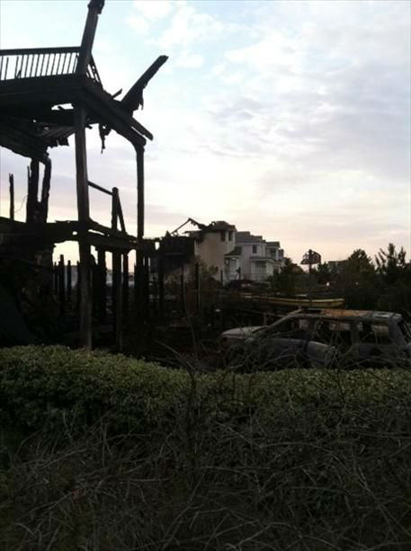 "<div class=""meta ""><span class=""caption-text "">Two homes were destroyed and a third heavily damaged by a fire in the Pine Island area of Corolla in Currituck County.  (WTVD Photo/ uReport image submitted by Scott Foster)</span></div>"