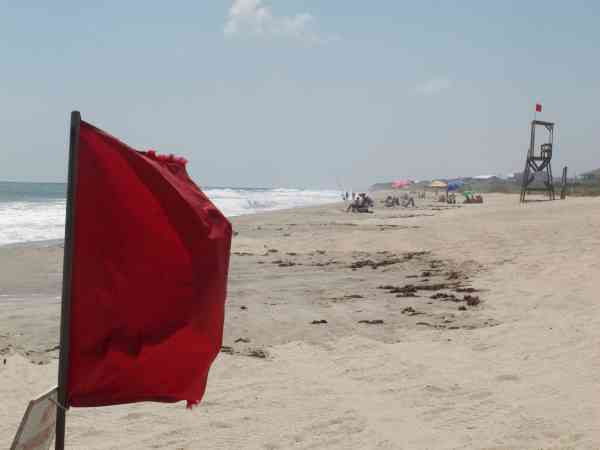 "<div class=""meta image-caption""><div class=""origin-logo origin-image ""><span></span></div><span class=""caption-text"">Red flags warn swimmers from the water at Kure Beach, N.C., as waves increase from Hurricane Earl beyond the horizon on Wednesday, Sept. 1, 2010.  (AP Photo/ Bruce Smith)</span></div>"