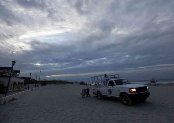 City workers remove a trash can along the beach as Hurricane Earl heads toward the eastern coast in Atlantic Beach, N.C., Thursday, Sept. 2, 2010.  <span class=meta>(AP Photo&#47; Chuck Burton)</span>