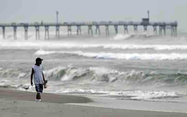 Almon Telling looks at the surf as he walks along the beach as Hurricane Earl heads toward the eastern coast in Atlantic Beach, N.C., Thursday, Sept. 2, 2010.  <span class=meta>(AP Photo&#47; Chuck Burton)</span>