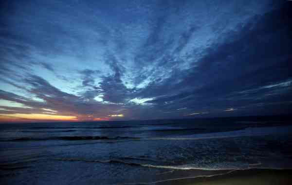 Clouds from the outer bands of Hurricane Earl appear over the Atlantic ocean at sunrise in Nags Head, N.C., Thursday, Sept. 2, 2010 as Earl approaches the east coast.  <span class=meta>(AP Photo&#47; Gerry Broome)</span>