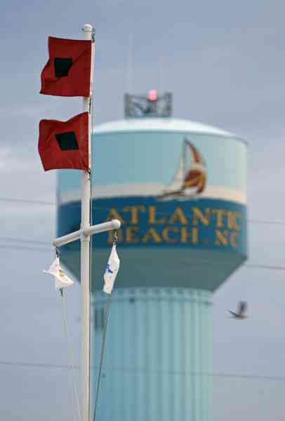 Hurricane flags blow in the wind as Hurricane Earl heads toward the eastern coast in Atlantic Beach, N.C., Thursday, Sept. 2, 2010.  <span class=meta>(AP Photo&#47; Chuck Burton)</span>