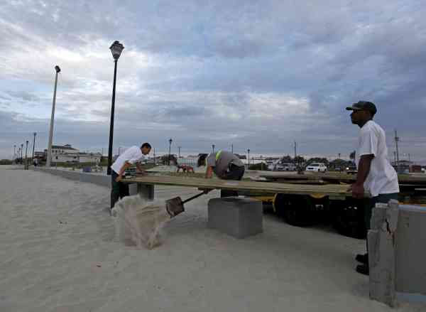 Town workers, from left, Jose Pineda, Travis Thompson, and Cager Jones, install barriers on the boardwalk as Hurricane Earl heads toward the eastern coast in Atlantic Beach, N.C., Thursday, Sept. 2, 2010.  <span class=meta>(AP Photo&#47; Chuck Burton)</span>