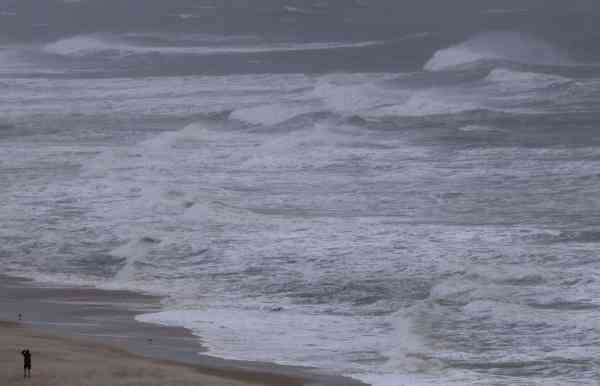 A man walks along the beach as Hurricane Earl churns up the eastern coast on Friday, Sept.  3, 2010 in Virginia Beach, Va.   <span class=meta>(AP Photo&#47; Evan Vucci)</span>