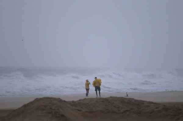 A couple walks along the beach as Hurricane Earl churns up the eastern coast on Friday, Sept.  3, 2010 in Virginia Beach, Va.   <span class=meta>(AP Photo&#47; Evan Vucci)</span>