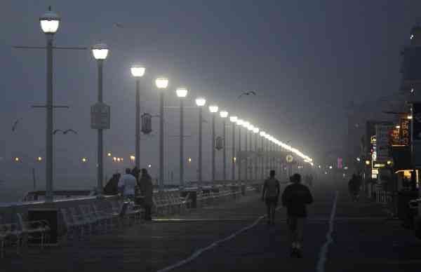 People walk along the boardwalk as as Hurricane Earl moved up the eastern coast, Friday, Sept. 3, 2010, in Ocean City, Md.  <span class=meta>(AP Photo&#47; Rob Carr)</span>