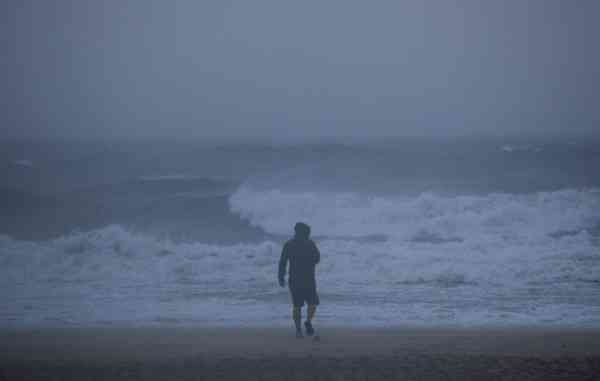 A man walks along the beach in the early morning as Hurricane Earl churns up the eastern coast on Friday, Sept.  3, 2010 in Virginia Beach, Va.   <span class=meta>(AP Photo&#47; Evan Vucci)</span>