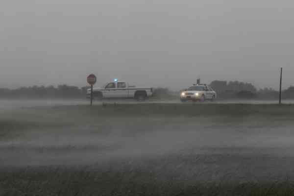 Authorities block highway 12 north of the Bonner Bridge near Nags Head, N.C., Friday, Sept. 3, 2010 as wind and rain from Hurricane earl sweep through the area.  <span class=meta>(AP Photo&#47; Gerry Broome)</span>