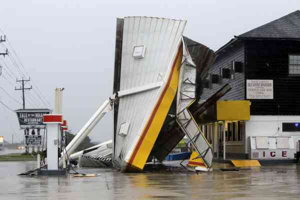 "<div class=""meta image-caption""><div class=""origin-logo origin-image ""><span></span></div><span class=""caption-text"">A metal roof is seen on the ground after winds from Hurricane Earl passed through overnight in Nags Head, N.C., Friday, Sept. 3, 2010.  (AP Photo/ Gerry Broome)</span></div>"