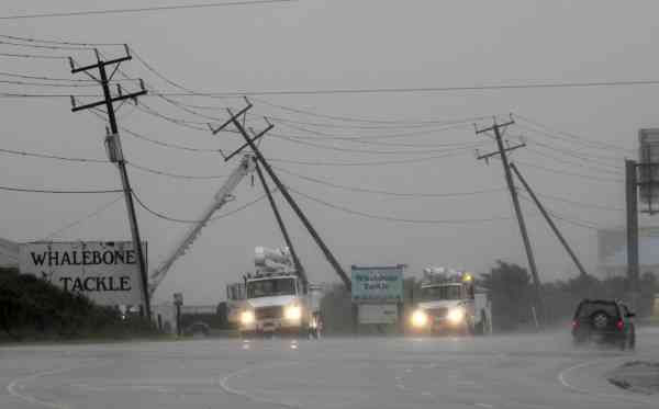 Utilities workers try to support power lines that were blown sideways from winds produced by Hurricane Earl in Nags Head, N.C., Friday, Sept. 3, 2010.  <span class=meta>(AP Photo&#47; Gerry Broome)</span>