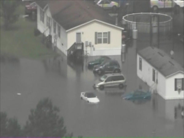 "<div class=""meta image-caption""><div class=""origin-logo origin-image ""><span></span></div><span class=""caption-text"">Pictures from Chopper 11 HD show Windsor, NC - about 120 miles east of Raleigh - inundated by the rising Cashie River. (WTVD Photo/ Chopper 11 HD)</span></div>"
