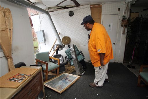 "<div class=""meta ""><span class=""caption-text "">Calvin Grandy looks at damage after floodwaters receded in Windsor, N.C., Sunday, Oct. 3, 2010.  (AP Photo/ Jim R. Bounds)</span></div>"