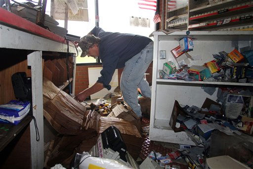 "<div class=""meta ""><span class=""caption-text "">Roy Stocks III cleans up at Roy's Service Center after floodwaters receded in  Windsor, N.C., Sunday, Oct. 3, 2010.   (AP Photo/ Jim R. Bounds)</span></div>"