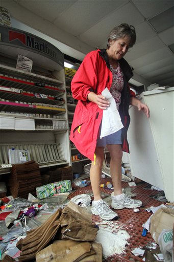 Marlene Johnson cleans up at Roy&#39;s Service Center after floodwaters receded in  Windsor, N.C., Sunday, Oct. 3, 2010.   <span class=meta>(AP Photo&#47; Jim R. Bounds)</span>