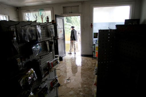 "<div class=""meta ""><span class=""caption-text "">Roy Stocks surveys the damage in his store, Roy's Service Center, after floodwaters receded in  Windsor, N.C., Sunday, Oct. 3, 2010. (AP Photo/ Jim R. Bounds)</span></div>"